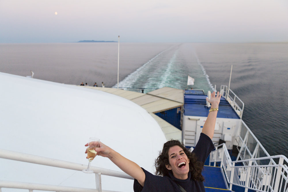 Sloane enjoying the sunset and moonrise on the Crown Seaways.