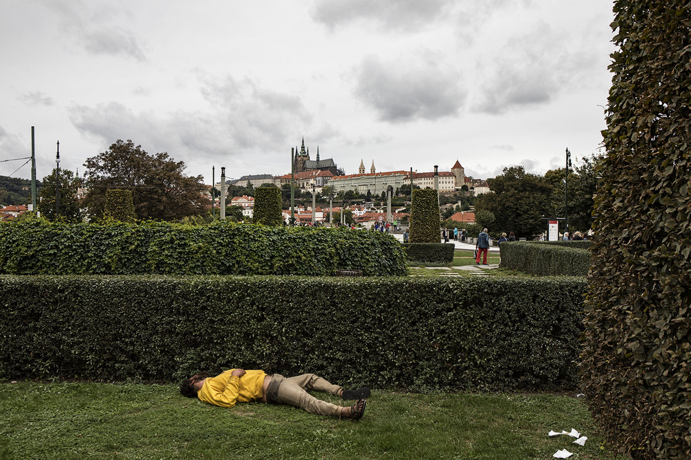 Highlight of the tour - this guy stole the show. Passed out in the middle of the afternoon - evidence suggests he may have taken a dump nearby, given the toilet paper strewn about.  Prague Castle in the background.