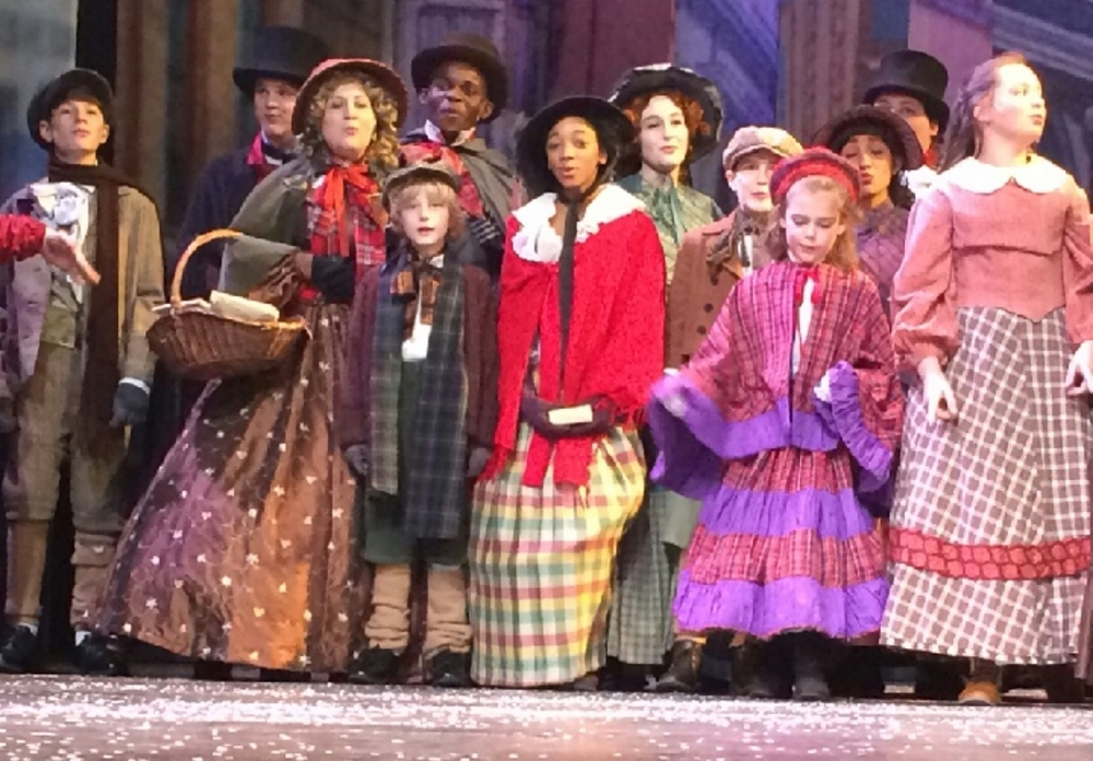 Claudia-Ruthie (pictured center in red shawl) is in the evening viewing of A Christmas Carol. The last performance is December 23!