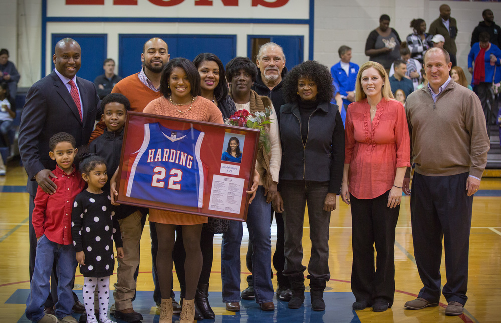 Retirement presentation at Harding Academy - Kaylah and her family, Coach Kevin Starks (far left) Coach Becky Starks (far right) and school president, Trent Williamson (far right).