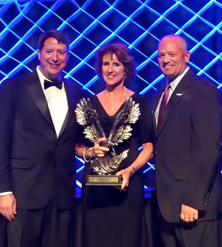L to R: Doug Browne, General Manager of The Peabody Hotel; Lauren McHugh Robinson, President and CEO of Huey's Restaurants; Ken Maples, TnHTA Chairman of the Board