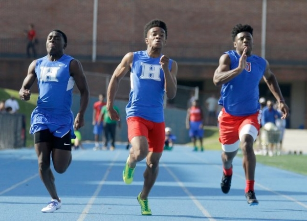 May 19, 2016: Harding Academy's Nicholas Martin, Calvin Austin III, and MUS's Maurice Hampton compete in the men's 100 meter dash during the D2 regional track meet held at MUS. Austin III finished the event in first place and set a region record with a time of 10.749. (Nikki Boertman/The Commercial Appeal)