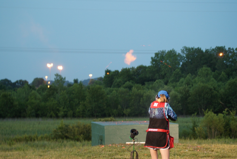 Brooke Kenworthy smashes a target under the lights in a shootoff for 3rd place.