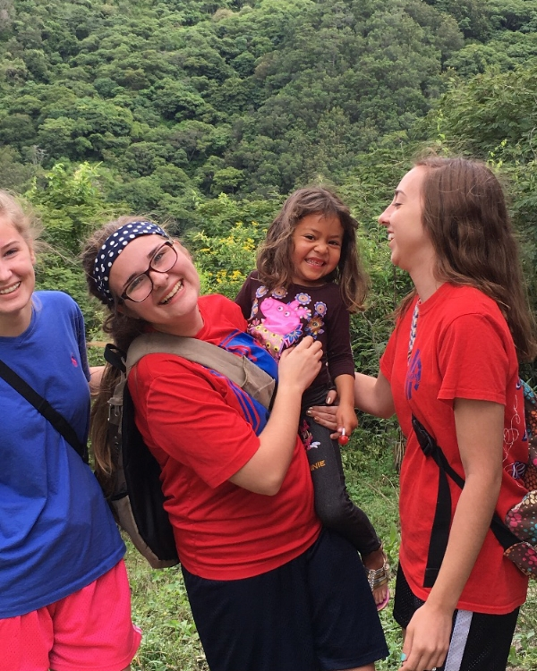 Our group spent a day in a remote village in the mountains. They assisted with a medical and dental clinic and held a VBS for the children. Here, Hannah Wright, Mallory Wyatt, and Deanna Hutson play with one of the children.