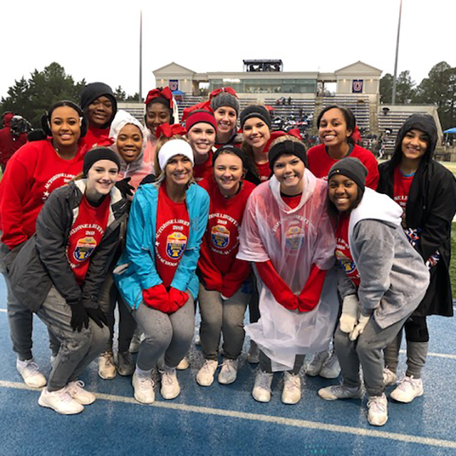 Varsity cheer came out to support the team.