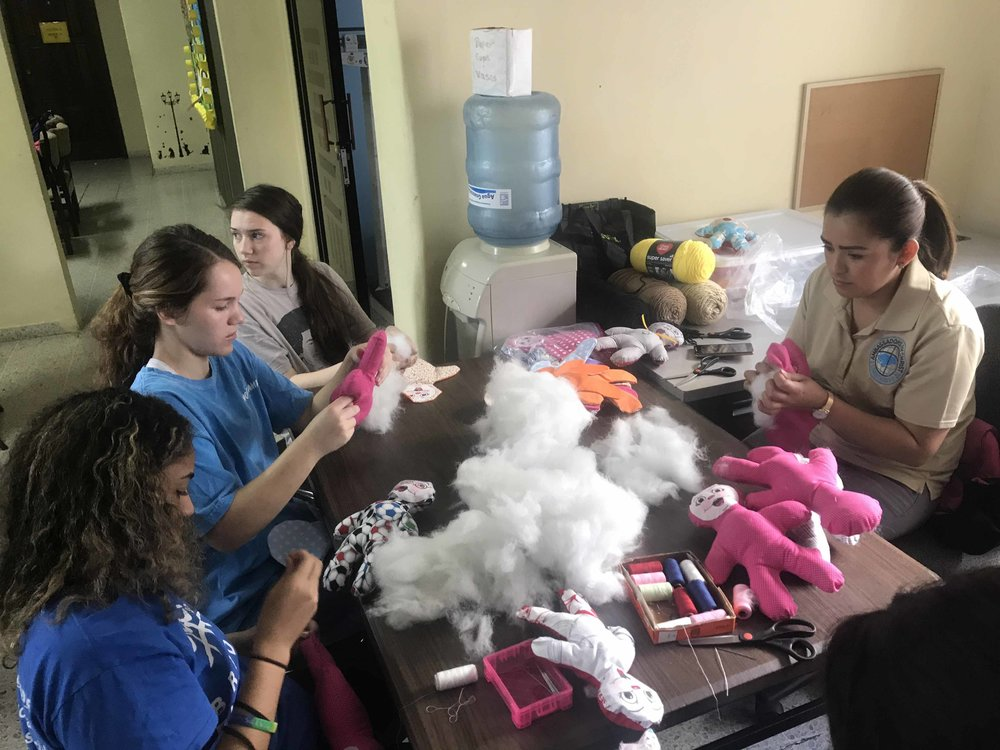 Making dolls for kids at the hospital.