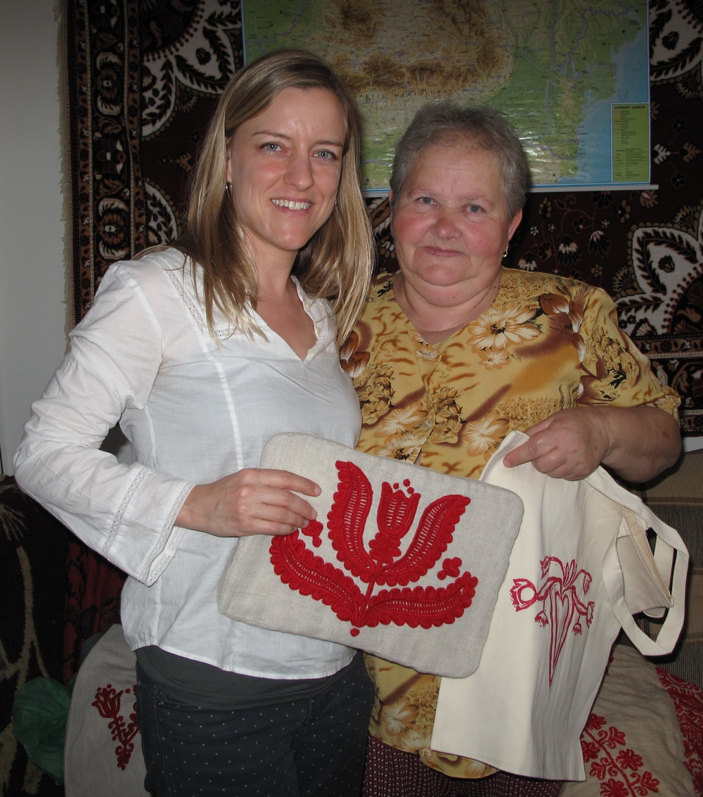 Here I am with artisan Piroska S. showing her work on the laptop case sample in her apartment in Banffyhunyad/ Huedin, October, 2013.