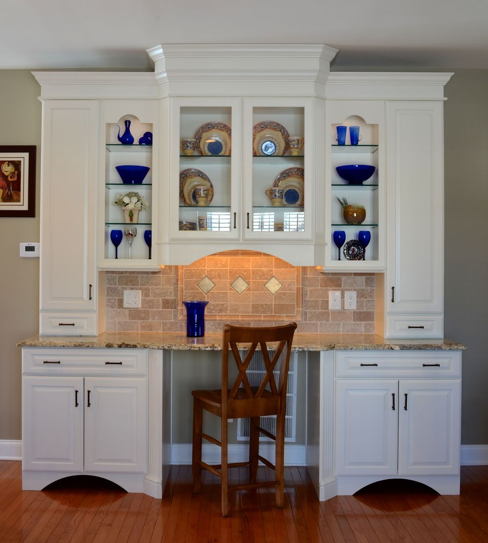 We used stock cabinetry to crate this free standing, multi-purpose hutch to look like a custom piece of furniture