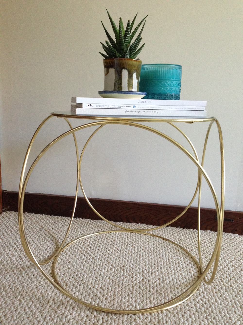 Brass side table with glass top, $10