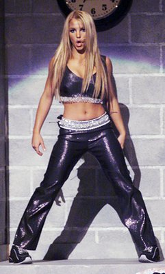 "Before *NSYNC took the stage, Britney performed ""...Baby One More Time""."