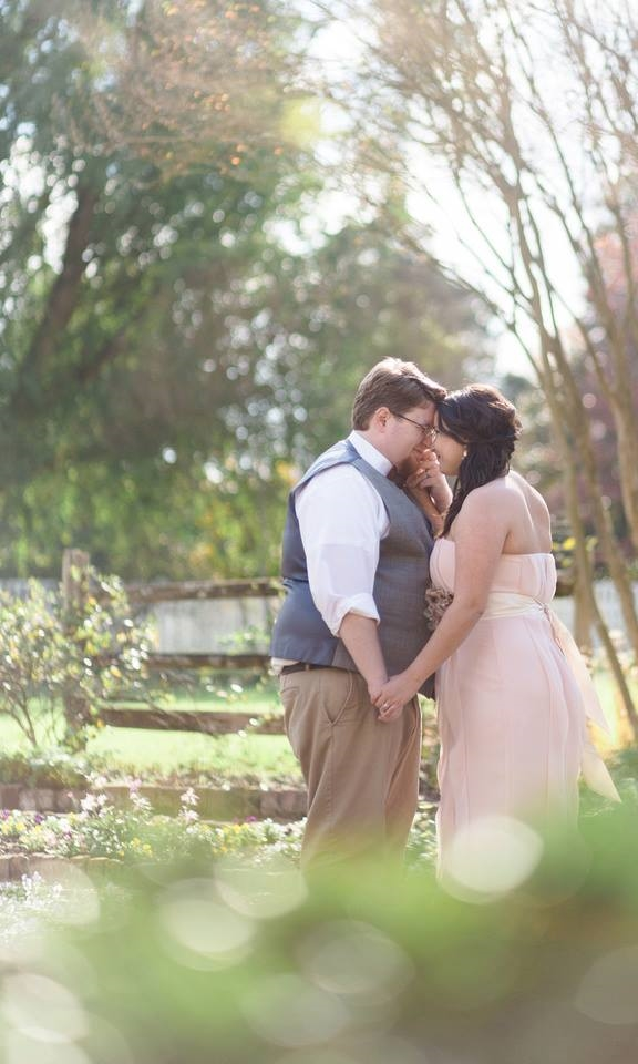 Sarah and Trey sharing a private moment in the Garden beside the Hermitage Mansion.