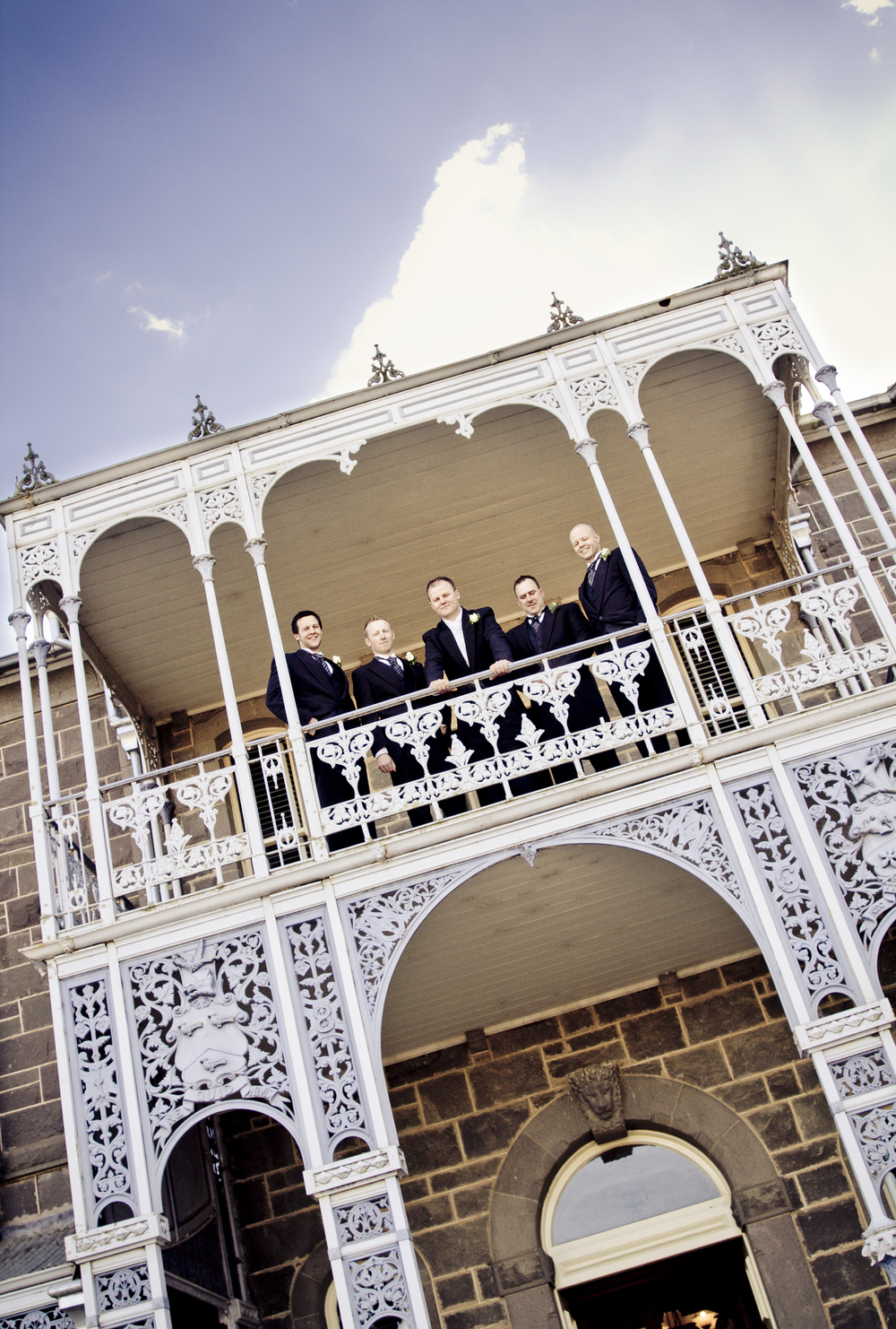 3 Groomsmen on balcony.jpg