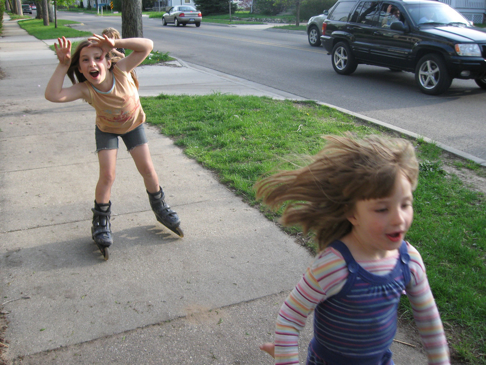 Grace and Rain rollerblading the neighborhood.