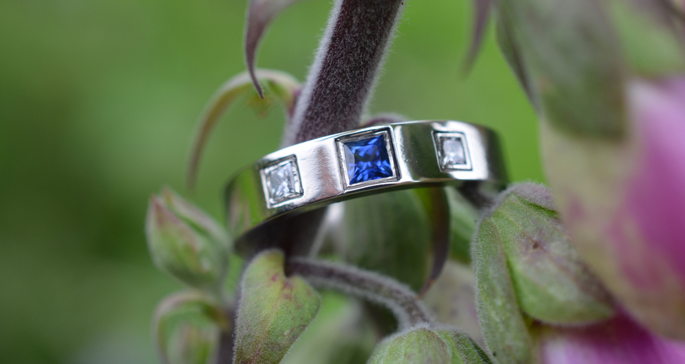Lynn wanted princess cut diamonds and a sapphire to compliment the stones in her engagement ring