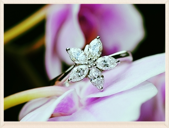photograpgh of finished ethical engagement ring made with marquise diamonds and recycled platinum