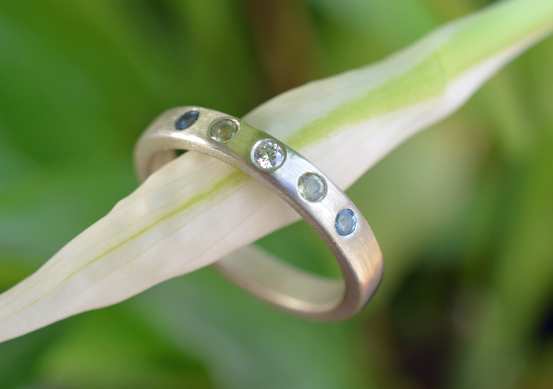 Diamonds, peridots & aquamarines in recycled white gold