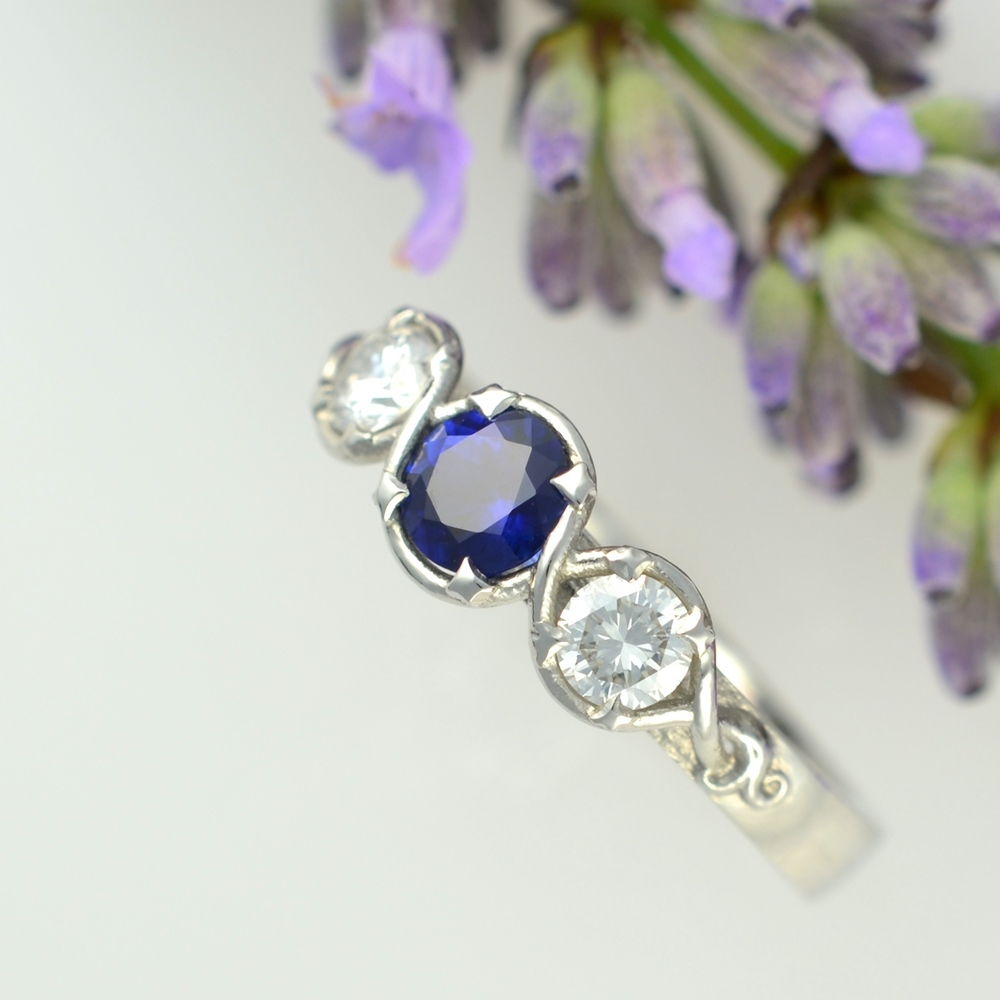 A beautiful sapphire provided by the customer accompanies these brilliant cut diamonds