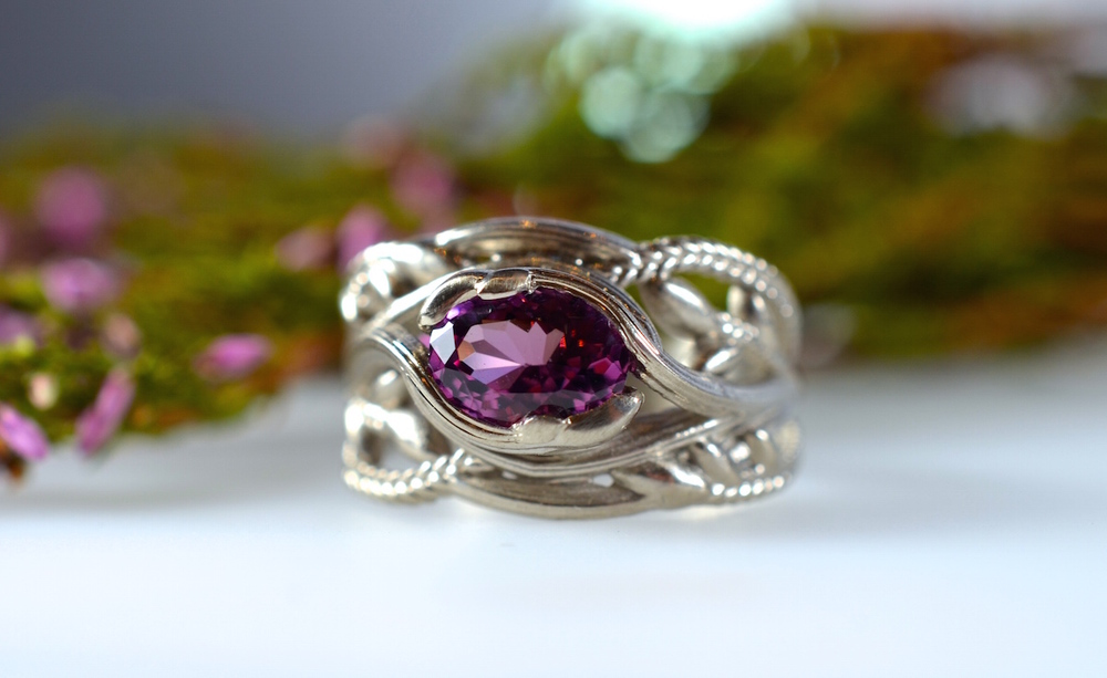 A recycled white gold, 'heather' spinel engagement ring