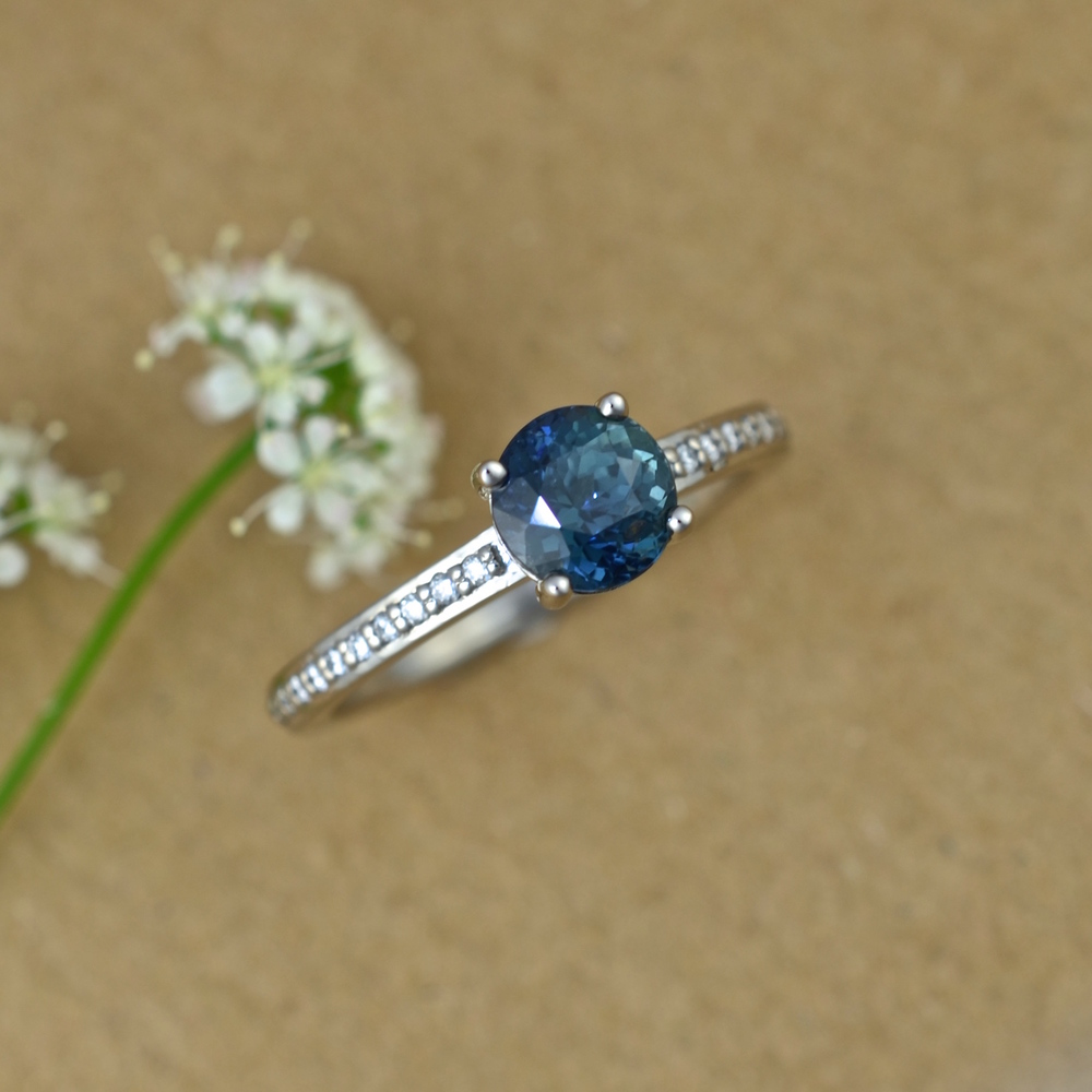 Sal's teal sapphire, diamond, white gold engagement ring