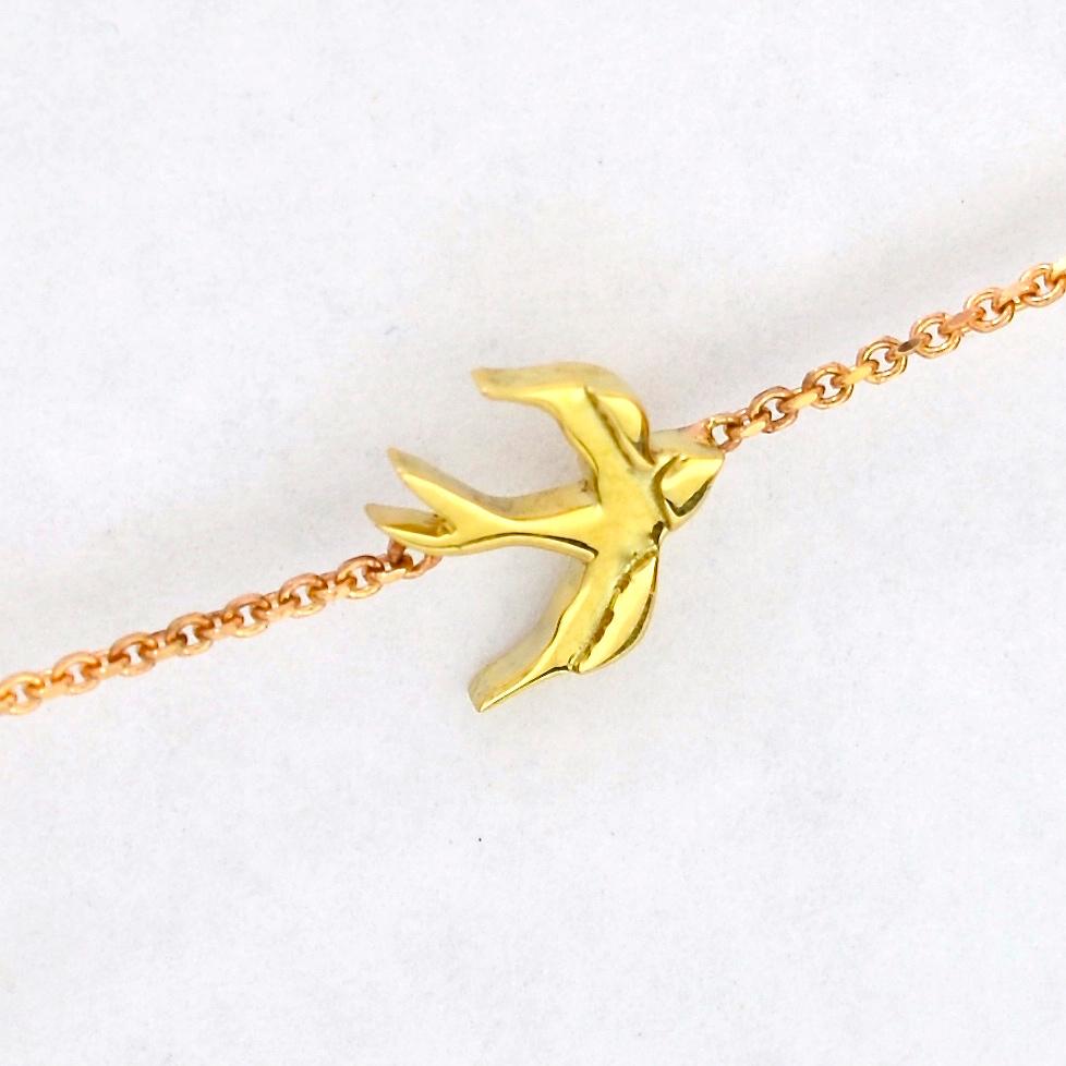 Yellow gold bird motif