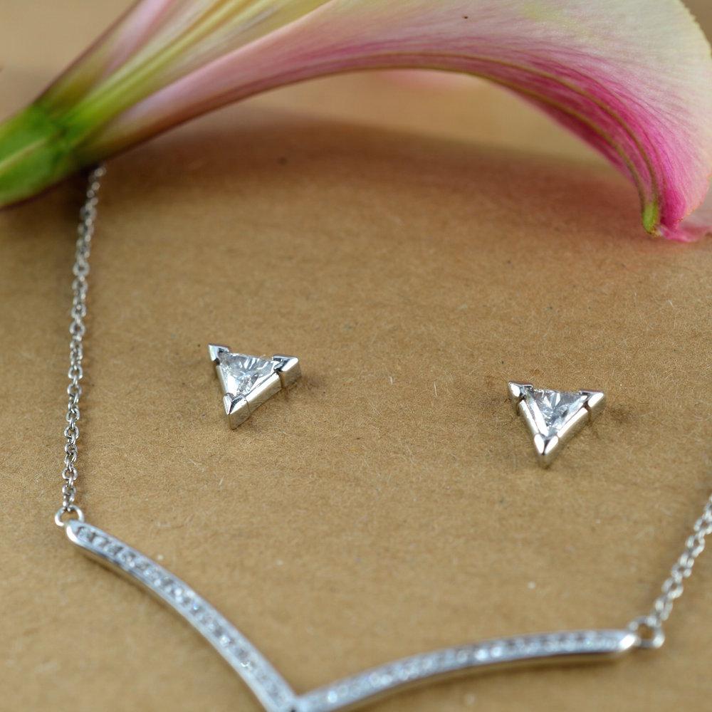 Trillion cut platinum earrings