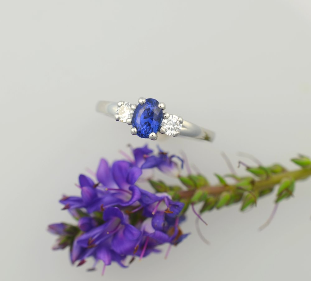 Sapphire with diamonds on the shoulders, set in recycled high palladium white gold