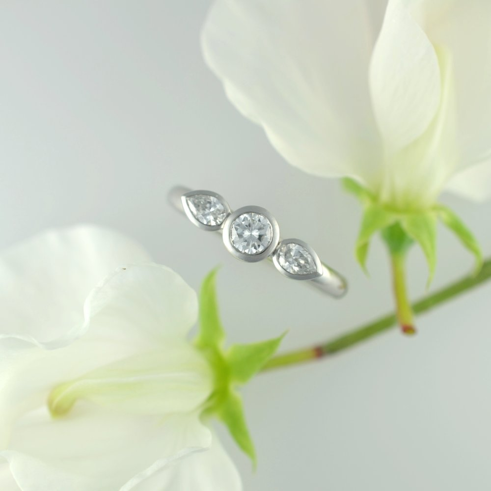 Classic pure platinum trilogy diamond engagement ring individually created