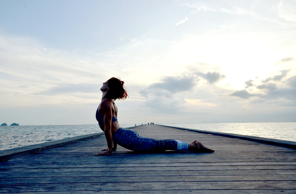 Kerill Ezzy, at a pier in Koh Samui, Thailand. She is dynamic powerhouse who trains with great passion and rigour. She will challenge you to the depths of your toes. Currently teaching in Macau, running workshops in Asia and soon Australia. Check her out:  http://kerillyoga.com/
