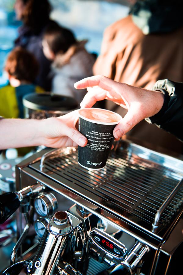 coffee exchanging hands.jpg