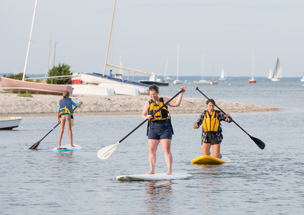 The MVFF's second annual SURF NIGHT on August 6, 2015, started with free community paddleboarding around Vineyard Haven Harbor, followed by an outdoor screening of surf films and a presentation by big-wave surfer Greg Long. Photo by Maria Thibodeau.