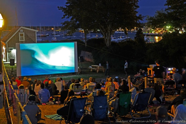 The MVFF's second annual SURF NIGHT on August 6, 2015, started with free community paddleboarding around Vineyard Haven Harbor, followed by an outdoor screening of surf films and a presentation by big-wave surfer Greg Long. Photo by Joshua Robinson-White.