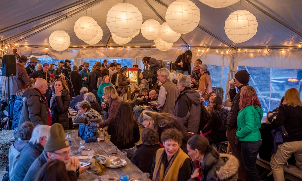 At our festival in March, you'll gather on hay bales and couches, and experience the magic of our community.