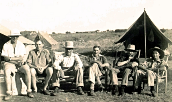 Louis Leakey, fourth from left, at campsite on expedition in Africa. C. 1929.
