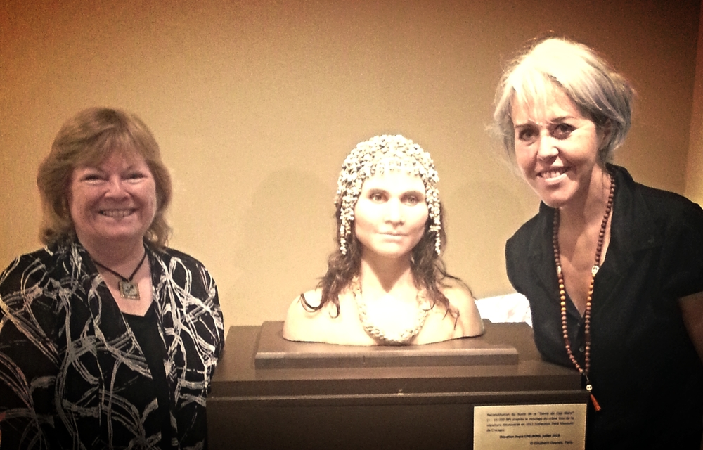 Leakey Fellow Jo Rodgers (L) and sculptor Élisabeth Daynès, in France, pictured with Daynès' bust of a Magdalenian woman.
