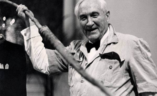 Louis Leakey showing off a spear at a fundraiser. Los Angeles, 1970.