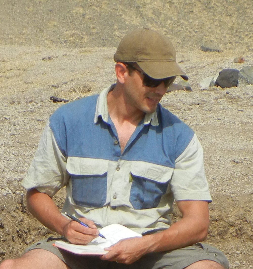 Tyler Faith recording archaeological and paleontological sites in the Lake Victoria region.