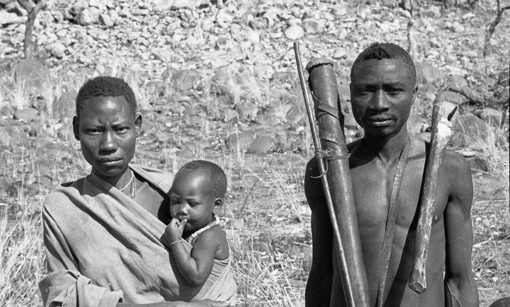 This image shows a Hazda couple and child in northern Tanzania in 1985. University of Utah anthropologist Kristen Hawkes and colleagues' research on Hazda led them to formulate the 'grandmother hypothesis' that grandmothering among early human relatives made the human lifespan evolve so it is much longer than lifespans of other apes. Now, a new study credits grandmothering for the human tendency to form couples or pair bonds. Photo credit: James F. O'Connell, University of Utah