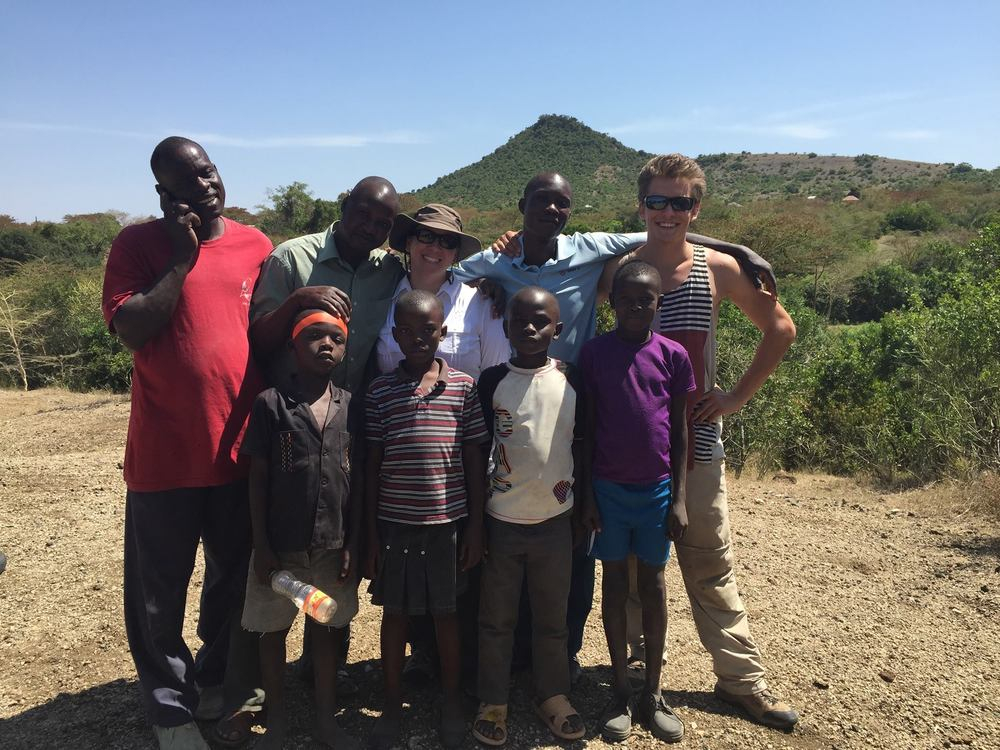 "From left to right (back row): Joshua Siembo, Francis Sina Muteti, Niki Garrett, Collins Ouma Ogongo, and Joel Torgeson.  Front row is a group of local kids from the island.  Taken at the ""bovid hill"" site. Photo credit:  Lauren Michel"