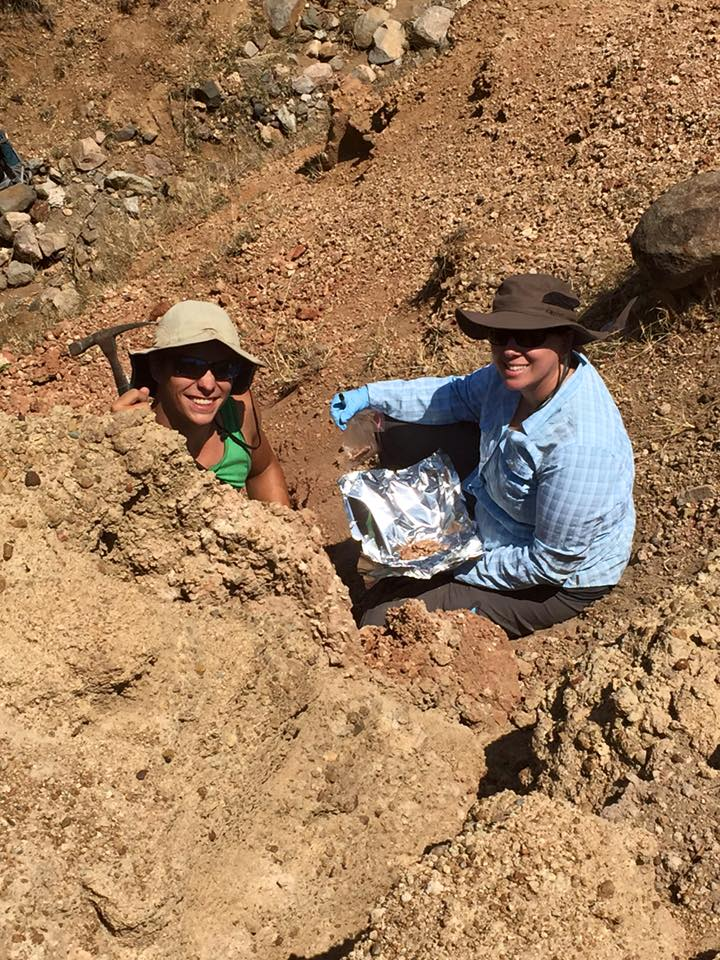 Joel Torgeson (L) and Lauren Michel (R) standing in the middle of the exposed Kiahera Formation paleosol trench. Photo credit:  Niki Garrett