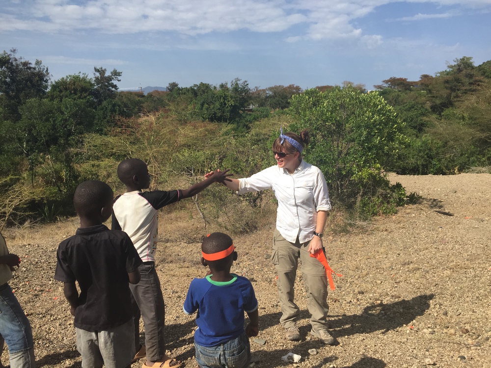 "Lauren Michel (R) interacting with some of the local kids at the ""bovid hill"" site. Photo credit:  Niki Garrett"