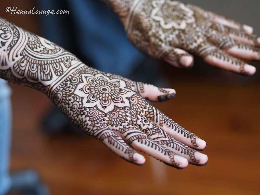 Mandalas on the backs of her hands. Henna by www.hennalounge.com