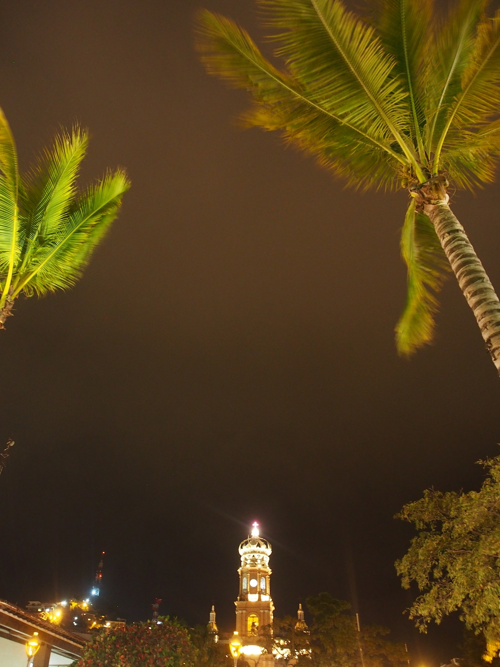 Walking along the malecon, with wind in the palms, the cathedral was all lit up, the crown jewel of Puerto Vallarta.