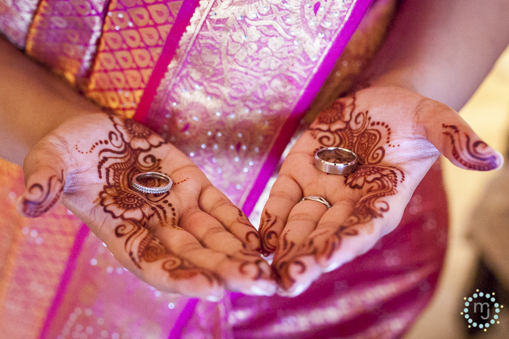 The bride's simple mehndi, glorious colorful sari and precious metals.