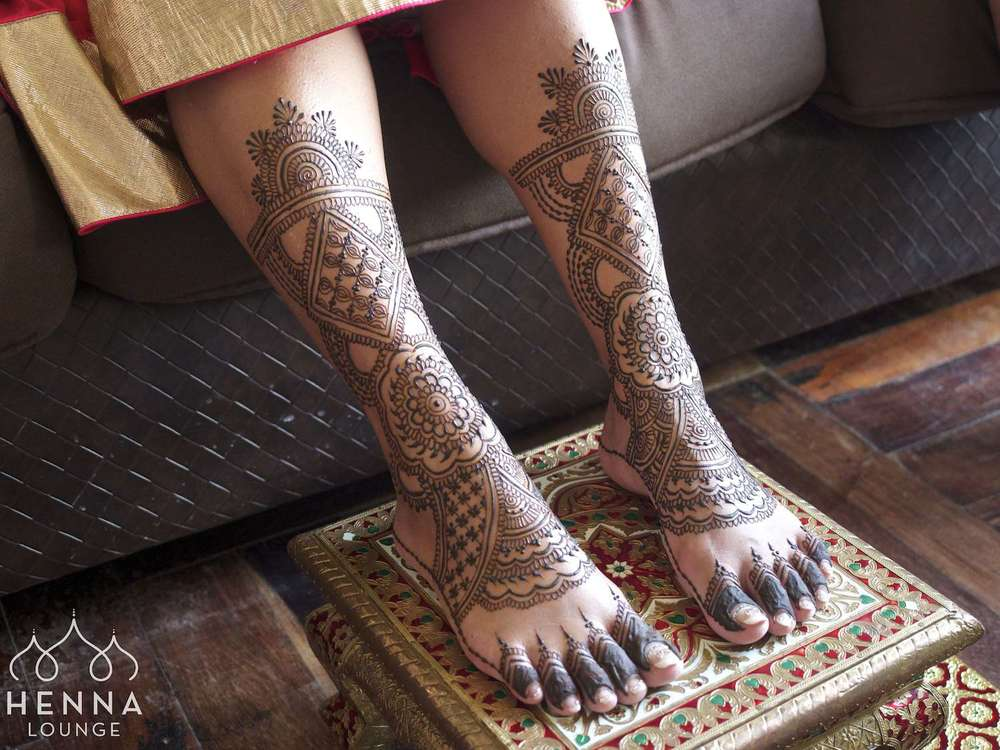 Elaborate mehndi feet
