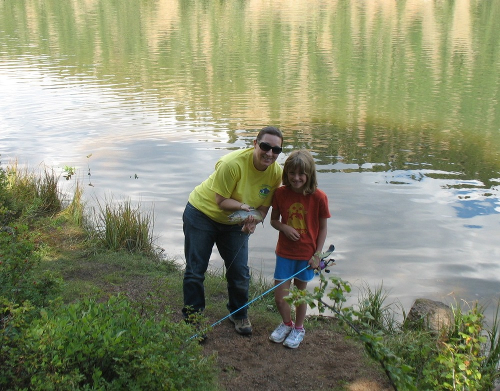 Stacie Gilmore (co-founder of ELK) and Emily Turner show off their catch at the BEDBUG event in 2011.  We are excited to join ELK in promoting environmental stewardship and getting our kids outdoors!