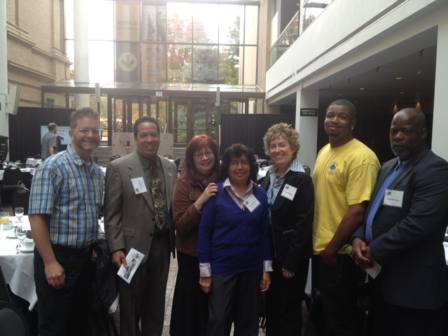 Alan Bucknam, Scott Gilmore, Maggie VanCleef, Loretta Pineda, ML Richardson, Dwayne Smallwood,  and David Burchette at ELK and Eggs at the Denver Museum of Nature and Science.