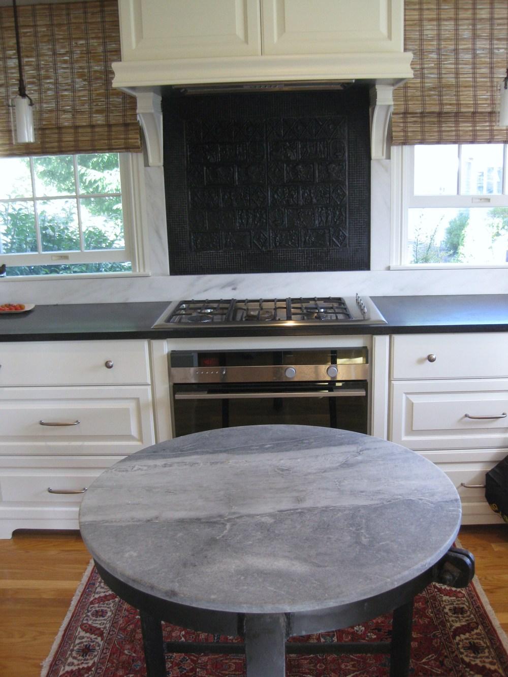 Black Marble Border Surrounding Cast Iron Fireplace Panels