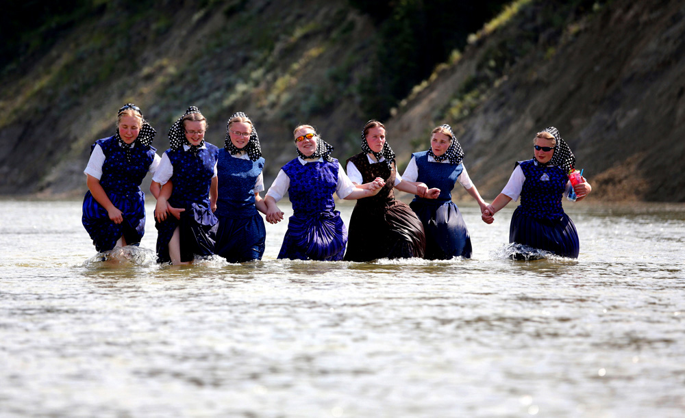 Hutterites cool off in the river
