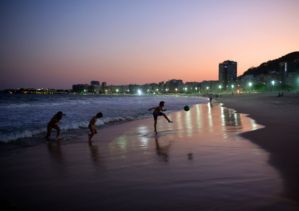 Sunset on the famous Copacabana beach in Rio De Janerio, Brazil