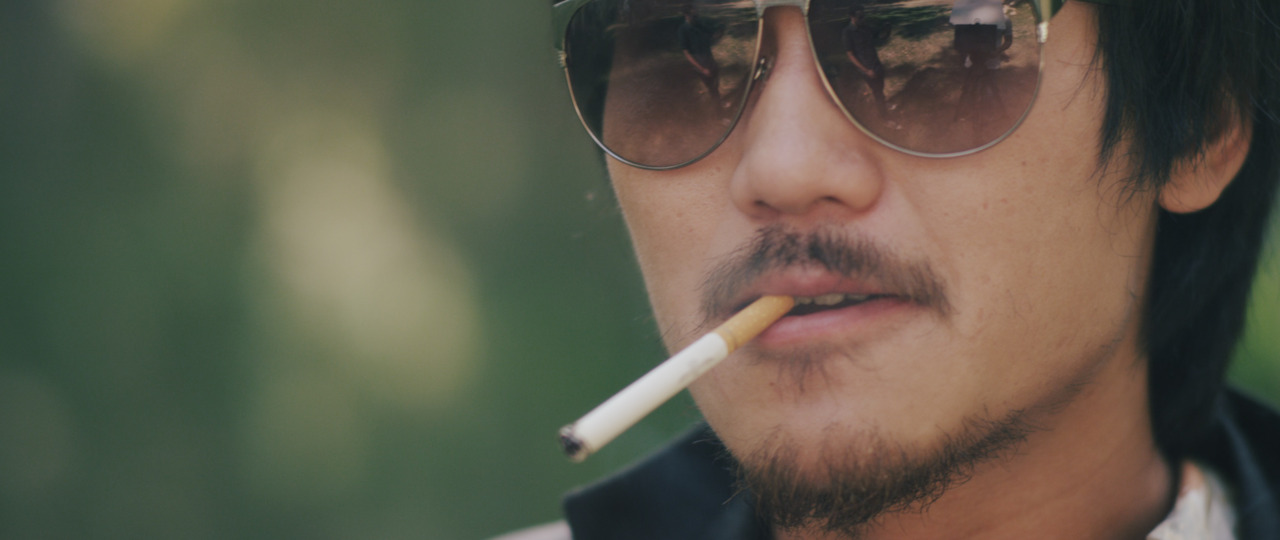 "jonjonaye :      ScreenShot Preview:  Here is a quick teaser photo taken from the footage for the "" Seijun Suzuki ,"" music video I recently shot for the Blue Scholars out here in LA. Gonna be epic. Haha. This is of my good friend Tao, Lei playing a lead henchman in the video."